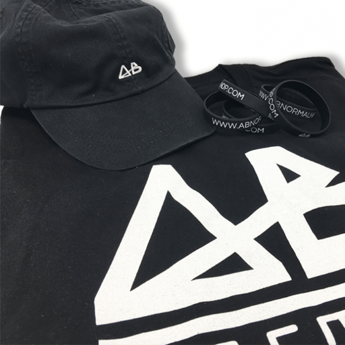 Matching collection of AB Normal apparel including an embroidered dad hat, a screen printed shirt, and wristbands.