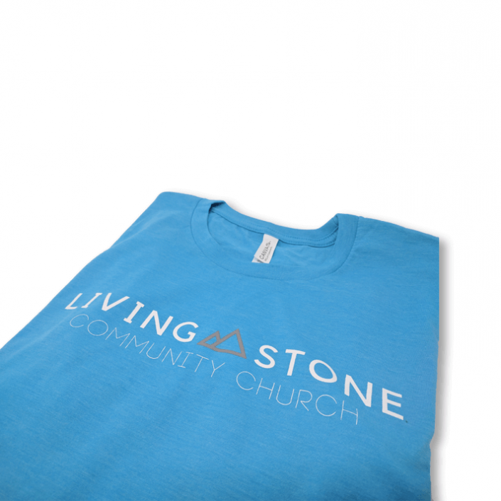 Baby blue colored shirt with the Living Stone Community Church logo screen printed on the front chest.