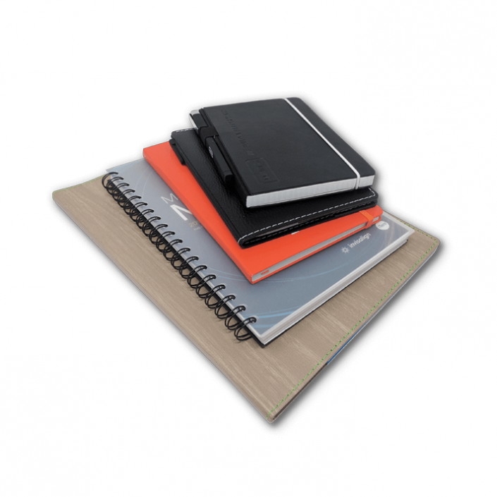 Stack of various notebooks and padfolios in various colors and sizes.
